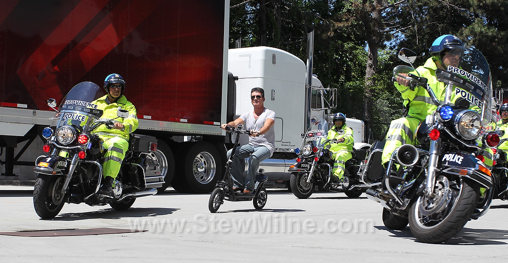 Simon Cowell arrives via scooter